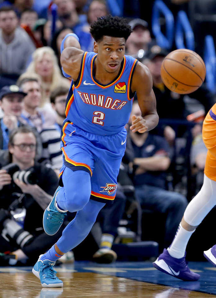Photo - Oklahoma City's Shai Gilgeous-Alexander (2) get a turnover during the NBA basketball game between the Oklahoma City Thunder and the Phoenix Suns at the Chesapeake Energy Arena in Oklahoma City , Friday, Dec. 20, 2019.   [Sarah Phipps/The Oklahoman]
