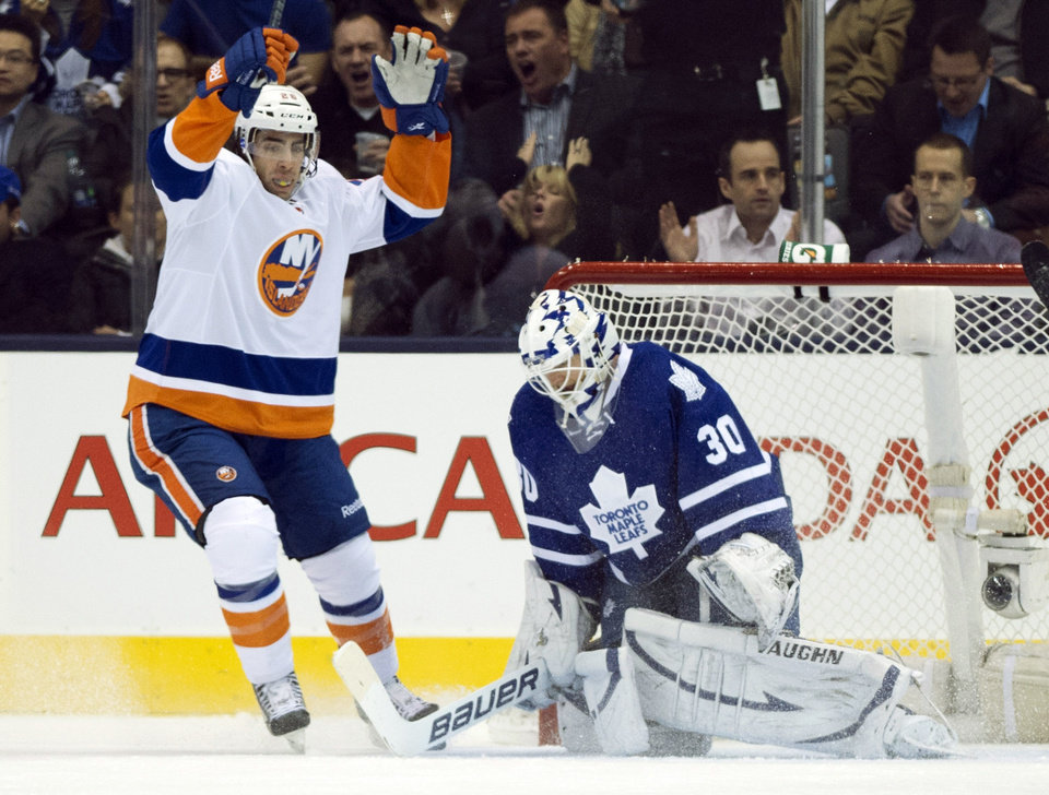 Toronto Maple Leafs goaltender Ben Scrivens reacts as New York Islanders left winger Matt Moulson (26) celebrates a goal during the second period of an NHL hockey game, Thursday, Jan. 24, 2013, in Toronto. (AP Photo/The Canadian Press, Frank Gunn)