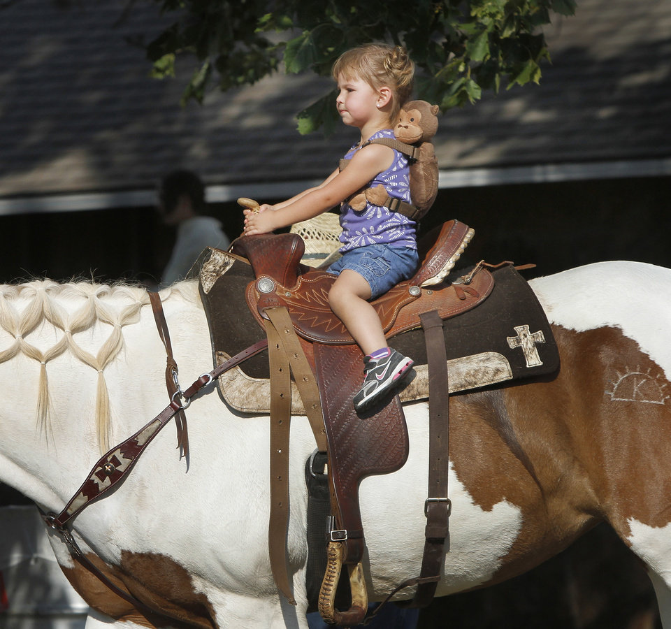 A child has the chance to ride a horse before  the Pawnee Bill Wild West Show begins in Pawnee, Oklahoma on Saturday,  June 23, 2012.  Photo by Jim Beckel, The Oklahoman