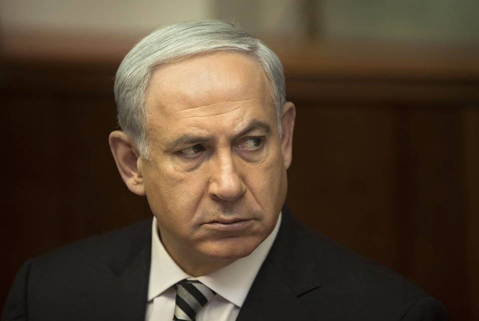 Photo -   Israeli Prime Minister Benjamin Netanyahu attends the weekly cabinet meeting in his Jerusalem office, Sunday, Nov. 11, 2012. Netanyahu says his country is ready to strike harder against Gaza Strip militants if they don't stop attacking Israel. (AP Photo/Sebastian Scheiner, Pool)