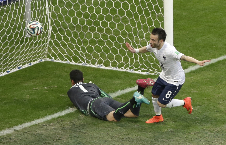 Photo - France's Mathieu Valbuena, right, celebrates scoring his side's third goal past Switzerland's goalkeeper Diego Benaglio during the group E World Cup soccer match between Switzerland and France at the Arena Fonte Nova in Salvador, Brazil, Friday, June 20, 2014. (AP Photo/Sergei Grits)
