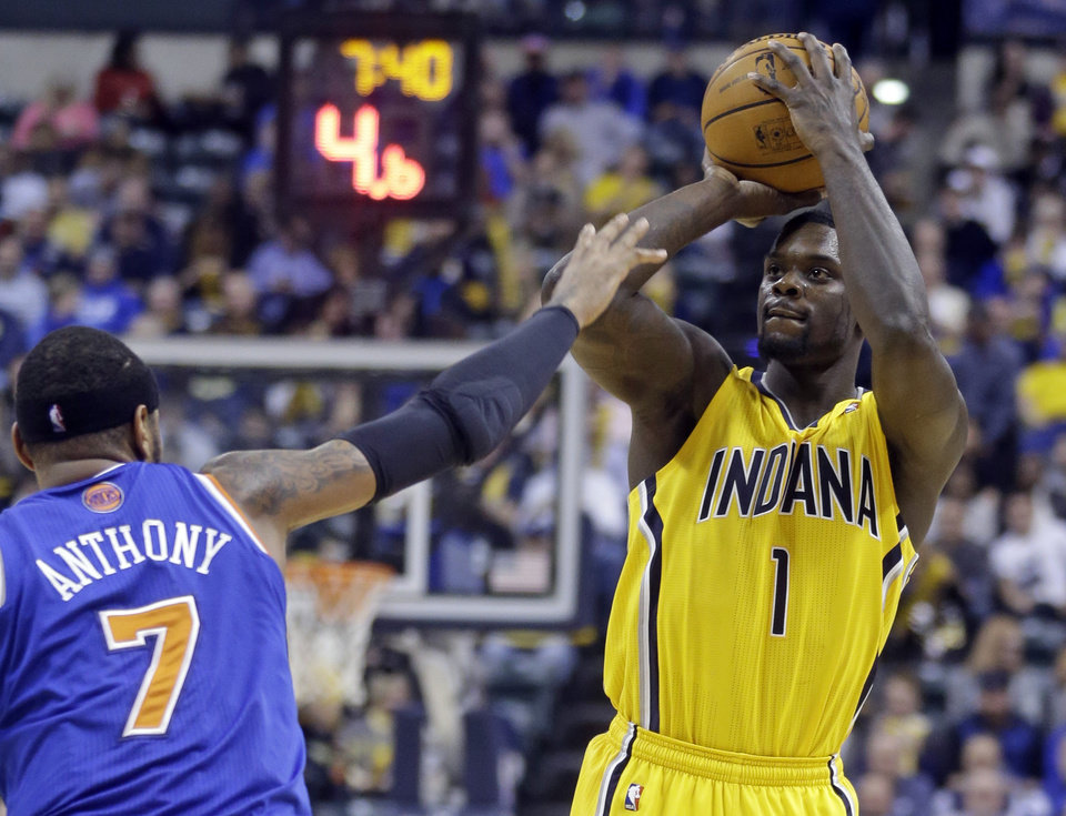 Photo - Indiana Pacers guard Lance Stephenson shoots over New York Knicks forward Carmelo Anthony during the second half of an NBA basketball game in Indianapolis, Thursday, Jan. 16, 2014. The Pacers defeated the Knicks 117-89. (AP Photo/Michael Conroy)