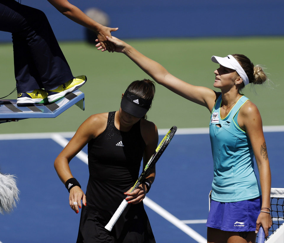 Photo - Kirolina Pliskova, of the Czech Republic, shakes hands with the umpire after defeating Ana Ivanovic, of Serbia, during the second round of the 2014 U.S. Open tennis tournament, Thursday, Aug. 28, 2014, in New York. (AP Photo/Frank Franklin II)