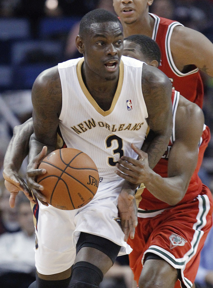 Photo - New Orleans Pelicans  guard Anthony Morrow (3) is grabbed from behind by Milwaukee Bucks guard Brandon Knight during the second half of an NBA basketball game in New Orleans, Friday, March 7, 2014. The Pelicans defeated the Bucks 112-104. (AP Photo/Bill Haber)