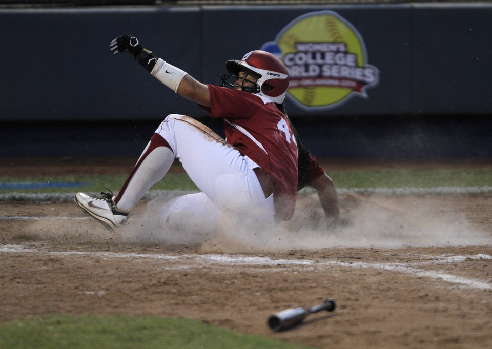 Oklahoma\'s Lauren Chamberlain (44) slides into home during a Women\'s College World Series game between OU and Alabama at ASA Hall of Fame Stadium in Oklahoma City, Monday, June 4, 2012. Photo by Garett Fisbeck, The Oklahoman