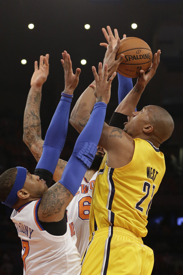 Photo - Indiana Pacers David West is guarded by New York Knicks Carmelo Anthony in the first quarter of Game 1 of their second-round NBA basketball series at Madison Square Garden in New York, Sunday, May 5, 2013.  (AP Photo/Kathy Willens)