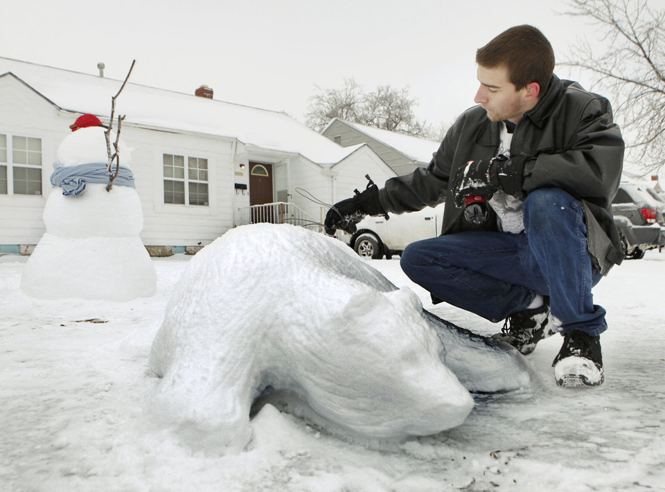 Photo - OKC resident Timothy Hickey puts the finishing touches on a Polar Bear at his home in Oklahoma City, OK, Saturday, Jan. 30, 2010. By Paul Hellstern, The Oklahoman