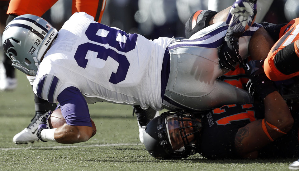Oklahoma State\'s Jordan Sterns (13) tackles Kansas State\'s Morgan Burns (33) during the second half of a college football game between the Oklahoma State University Cowboys (OSU) and the Kansas State University Wildcats (KSU) at Boone Pickens Stadium in Stillwater, Okla., Saturday, Oct. 5, 2013. OSU won 33-29.Photo by Sarah Phipps, The Oklahoman