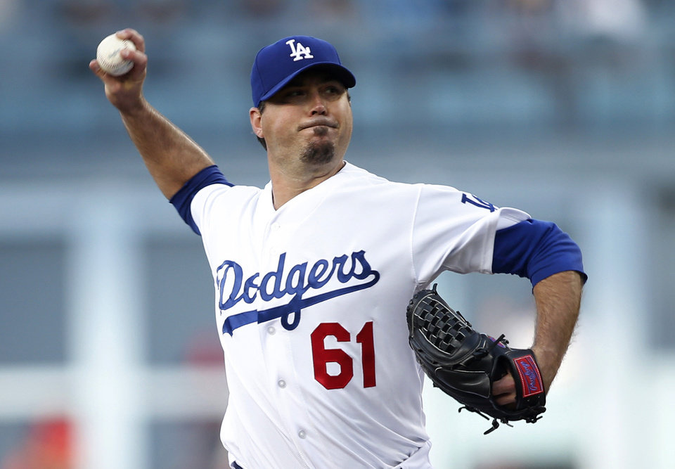 Photo - Los Angeles Dodgers' starting pitcher Josh Beckett delivers against the St. Louis Cardinals during the first inning of a baseball game, Thursday, June 26, 2014, in Los Angeles. (AP Photo/Danny Moloshok)