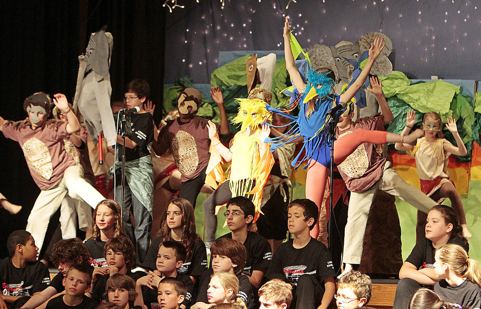 "Photo - Students sing a song from ""Lion King"" during the fifth grade musical at Chisholm Elementary in Edmond."