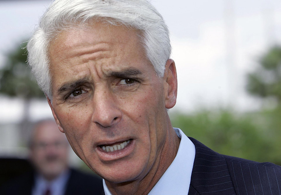 FILE - In this April 5, 2007 file photo, Florida Gov. Charlie Crist talks to the media at the Miami airport, about the plan to restore voting and other civil rights to felons who have finished their sentences. Former Florida Gov. Charlie Crist has announced on Twitter that he\'s joining the Democratic Party, Friday, Dec. 7, 2012. (AP Photo/Alan Diaz, File)