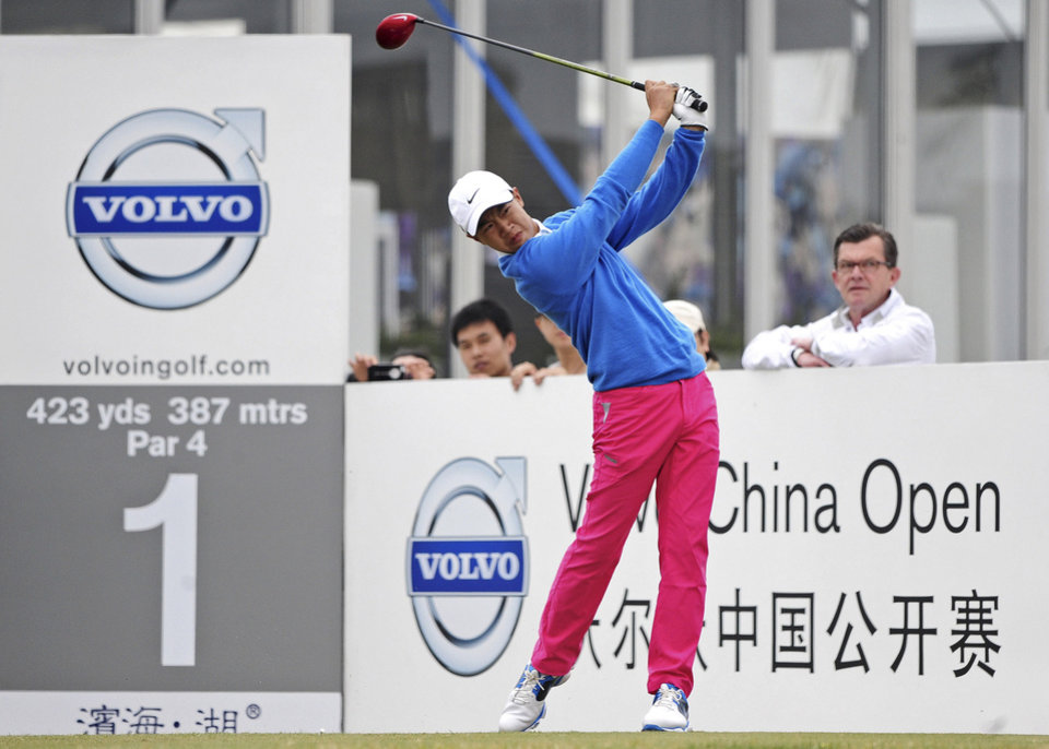 12-year-old Chinese amateur golfer Ye Wocheng watches his tee shot on the second day of the Volvo China Open at the Tianjin Binhai Lake Golf Club in north China's Tianjin Municipality Friday, May 3, 2013. Ye became the youngest player ever to compete in a European Tour event. (AP Photo) CHINA OUT