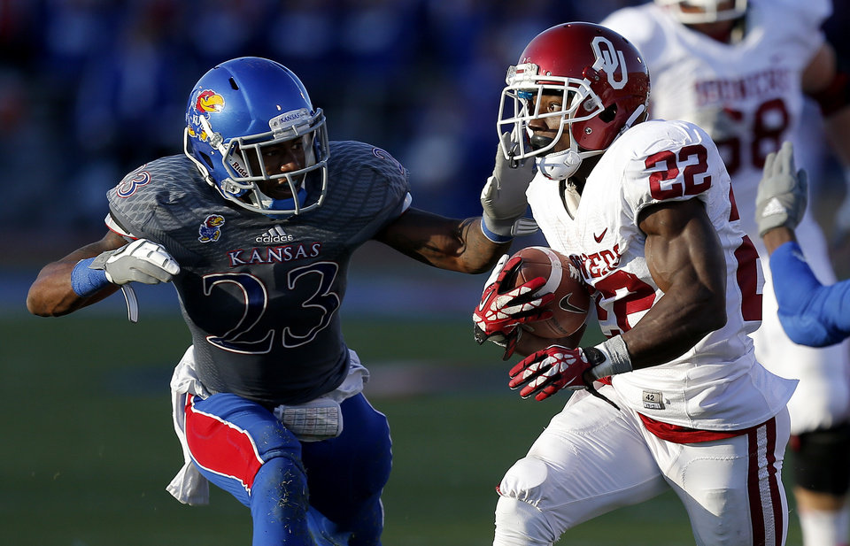 OU\'s Roy Finch (22) tries to get past KU\'s Dexter Linton (23) during the college football game between the University of Oklahoma Sooners (OU) and the University of Kansas Jayhawks (KU) at Memorial Stadium in Lawrence, Kan., Saturday, Oct. 19, 2013. Oklahoma won 34-19. Photo by Bryan Terry, The Oklahoman