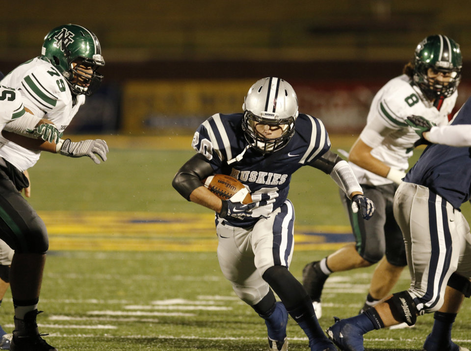 EN#20 Zack Jenkins blasts through a big hole in the line during the high school football game between Norman North and Edmond North in Edmond at Wantland Stadium Friday, Friday, October 18, 2013.  Photo by Doug Hoke, The Oklahoman