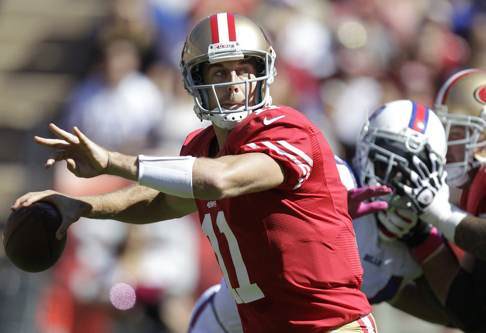 Photo -   San Francisco 49ers quarterback Alex Smith (11) passes against the Buffalo Bills during the first quarter of an NFL football game, Sunday, Oct. 7, 2012, in San Francisco. (AP Photo/Tony Avelar)