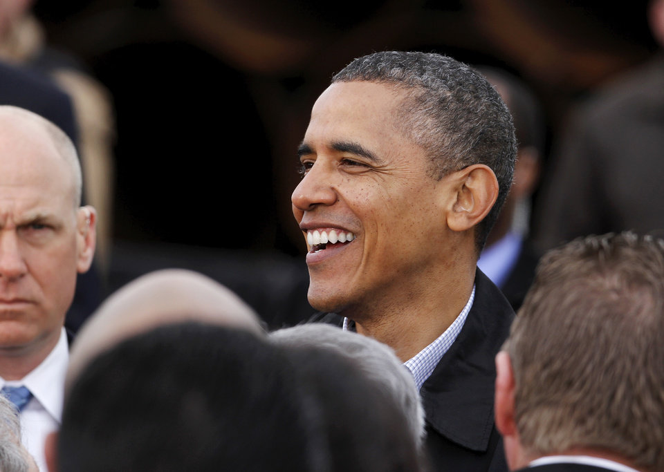 Photo - President Obama smiles and laughs as he greets people in the crowd after his speech. With  large oil pipe stacked 20 feet high as a backdrop, President Barack Obama delivered a speech promoting his administration's energy policies  to a group of about 200 invited guests at a pipe storage  yard just north of Ripley Thursday morning,  March 22, 2012.   Photo by Jim Beckel, The Oklahoman