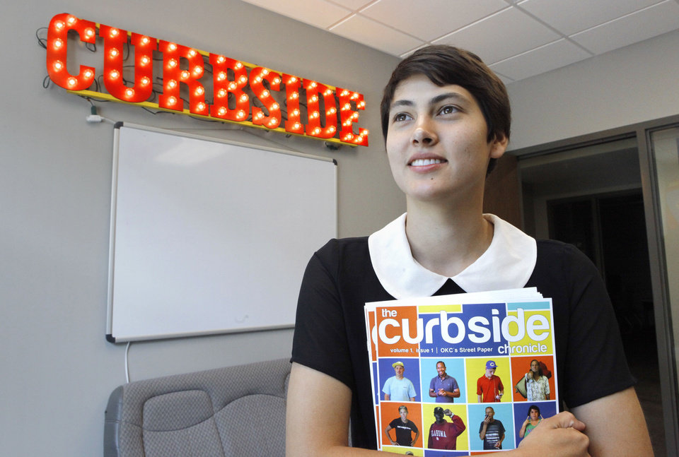 Photo - Editor Ranya Forgotson with one of the first issues of