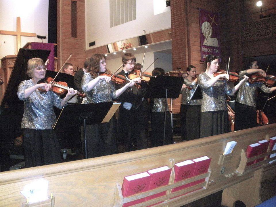Photo - Director Anne Guevara leads the Silver Strings of Putnam City. PHOTO PROVIDED