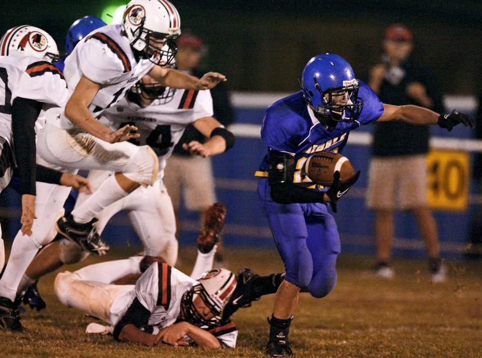 Dibble's Seth Hamby runs past Rush Springs defenders during a high school football game in Dibble, Okla., Thursday, Oct. 20, 2011. Photo by Bryan Terry, The Oklahoman