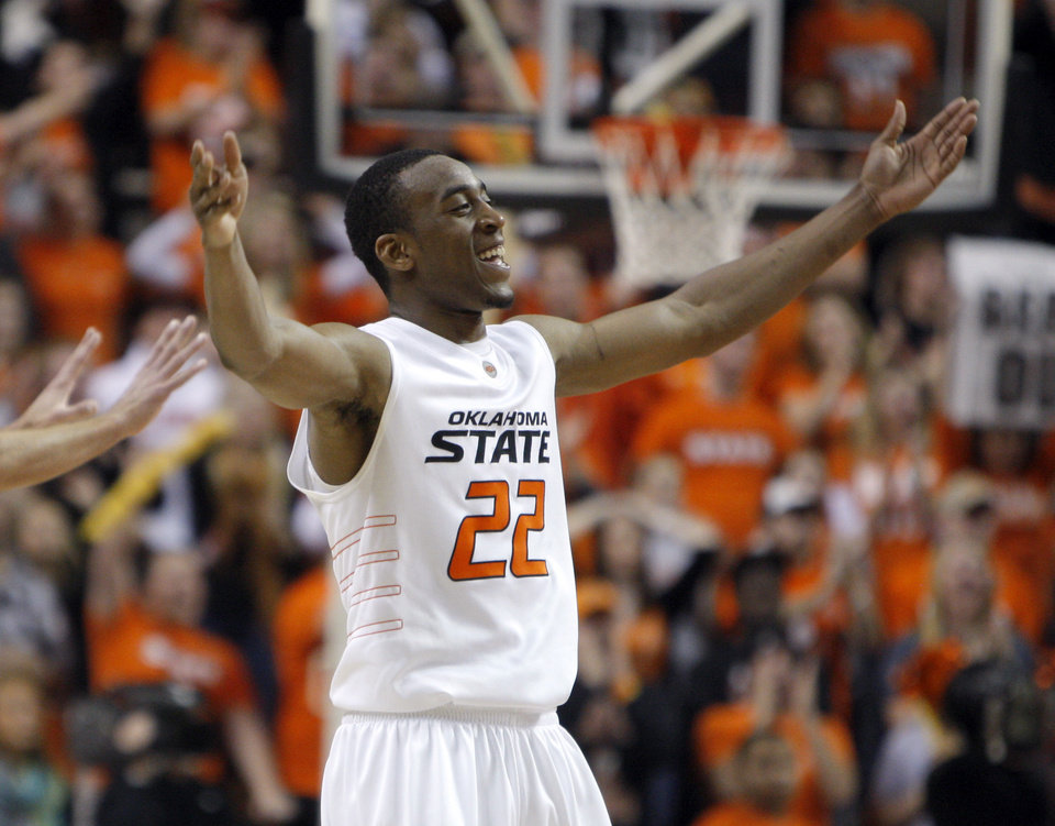 Photo - Oklahoma State's Markel Brown (22) celebrates during the Bedlam men's college basketball game between the University of Oklahoma Sooners and Oklahoma State University Cowboys at Gallagher-Iba Arena in Stillwater, Okla., Saturday, February, 5, 2011. Photo by Sarah Phipps, The Oklahoman