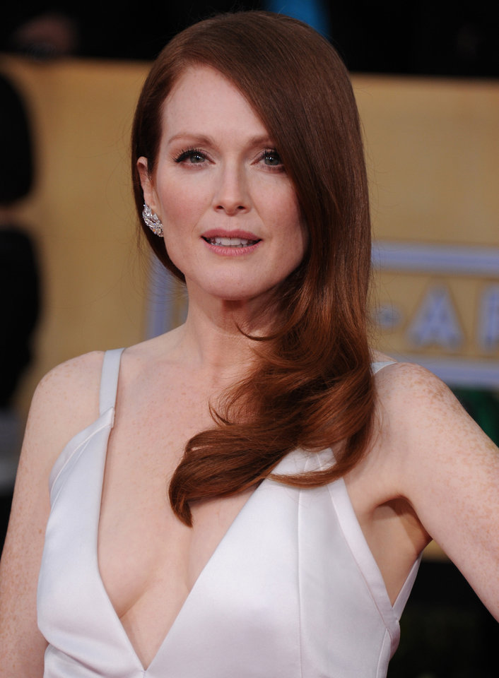 Photo - Actress Julianne Moore arrives at the 19th Annual Screen Actors Guild Awards at the Shrine Auditorium in Los Angeles on Sunday Jan. 27, 2013. (Photo by Jordan Strauss/Invision/AP)