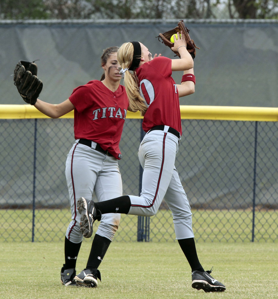Photo - Carl Albert outfielder Morgan Heard makes an out against Collinsville at the 2012 State Fast-Pitch Softball Tournament on Thursday, Oct. 11, 2012 at ASA Hall of Stadium in Oklahoma City, Okla.  Photo by Steve Sisney, The Oklahoman