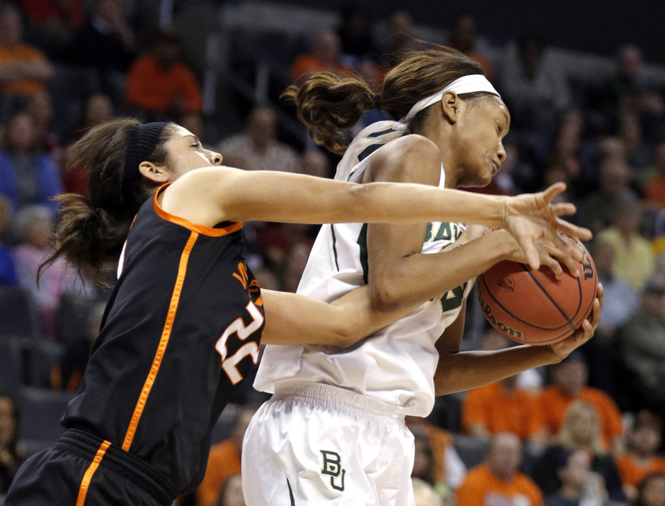 Photo - Oklahoma State's Brittney Martin (22) and Baylor's Nina Davis (13) battle for a rebound  during the Women's Big 12 basketball tournament game between Baylor and Oklahoma State at Chesapeake Energy Arena  in Oklahoma City, Okla., Sunday, March 9, 2014. Photo by Sarah Phipps, The Oklahoman