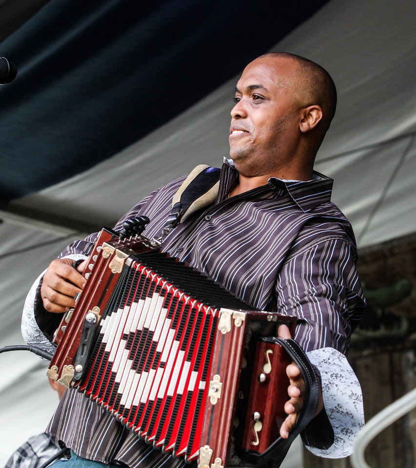Photo - Corey Ledet and his Zydeco band perform on the Fais Do Do stage during the New Orleans Jazz and Heritage Festival in New Orleans, Friday, April 26, 2013. (AP Photo/Doug Parker)