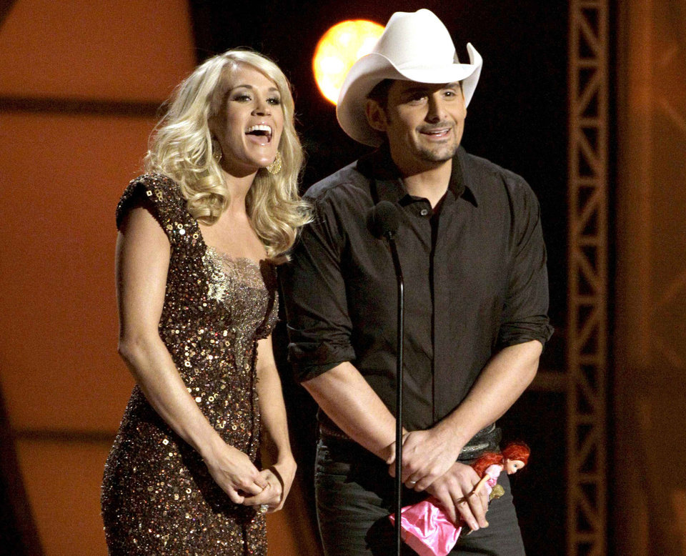 FILE - In this Nov. 9, 2011 file photo hosts Carrie Underwood, left, and Brad Paisley speak during the 45th Annual CMA Awards in Nashville, Tenn. The former �American Idol� winner's latest album �Blown Away� was a multi-week No. 1 on the country albums chart, she's in the midst of an arena tour and she also is up for female vocalist of the year at the CMA Awards, on Thursday, Nov. 1, 2012, airing live on ABC at 8 p.m. EDT from Nashville's Bridgestone Arena. (AP Photo/Mark Humphrey, File)