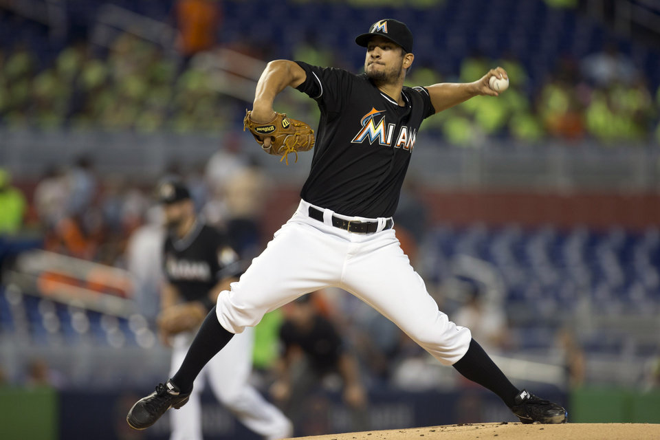 Photo - Miami Marlins starter Brad Hand pitches to the Washington Nationals during the first inning of a baseball game in Miami, Wednesday, July 30, 2014. (AP Photo/J Pat Carter)
