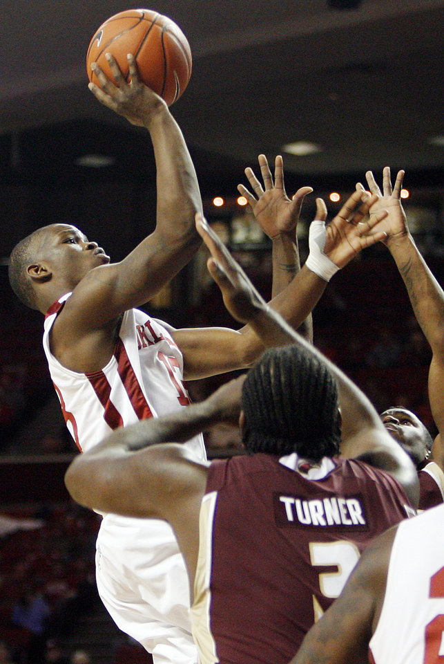 Photo - OU's Willie Warren (13) takes a shot during the second half of the men's college basketball game between the Oklahoma Sooners and Louisiana-Monroe at Lloyd Noble Center in Norman, Okla., Tuesday, Nov. 17, 2009. OU won, 72-61. Photo by Nate Billings, The Oklahoman