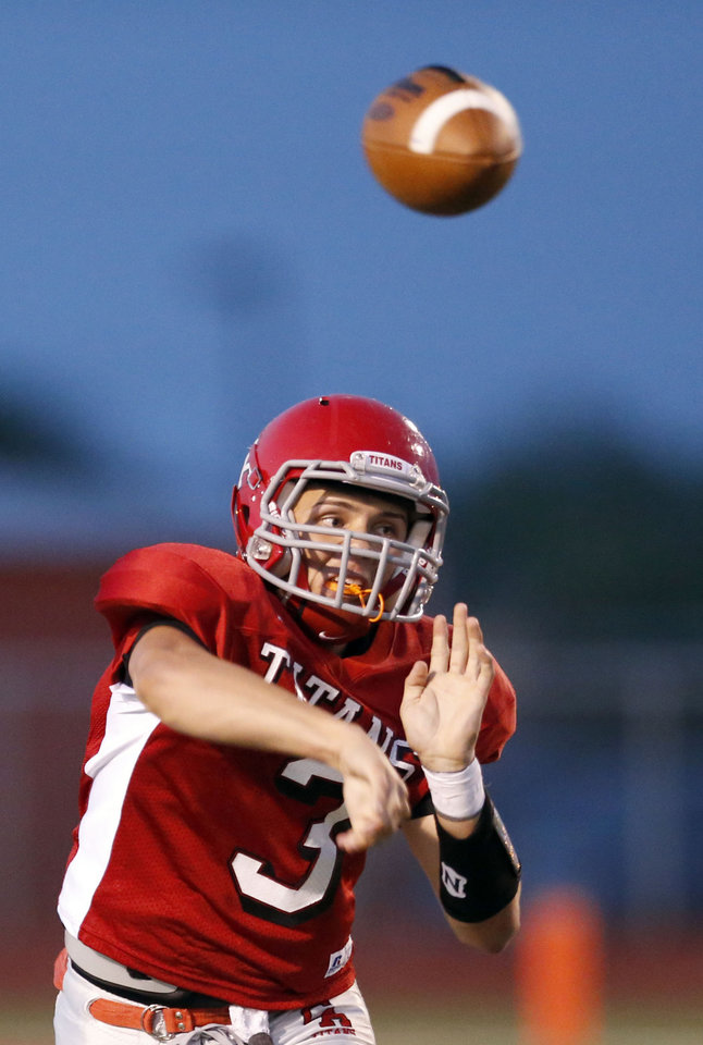 Photo - Carl Albert's Steven Thompson throws a pass during a high school scrimmage between Carl Albert High School and Del City at Carl Albert High School Friday, Aug. 17, 2012. Photo by Sarah Phipps, The Oklahoman