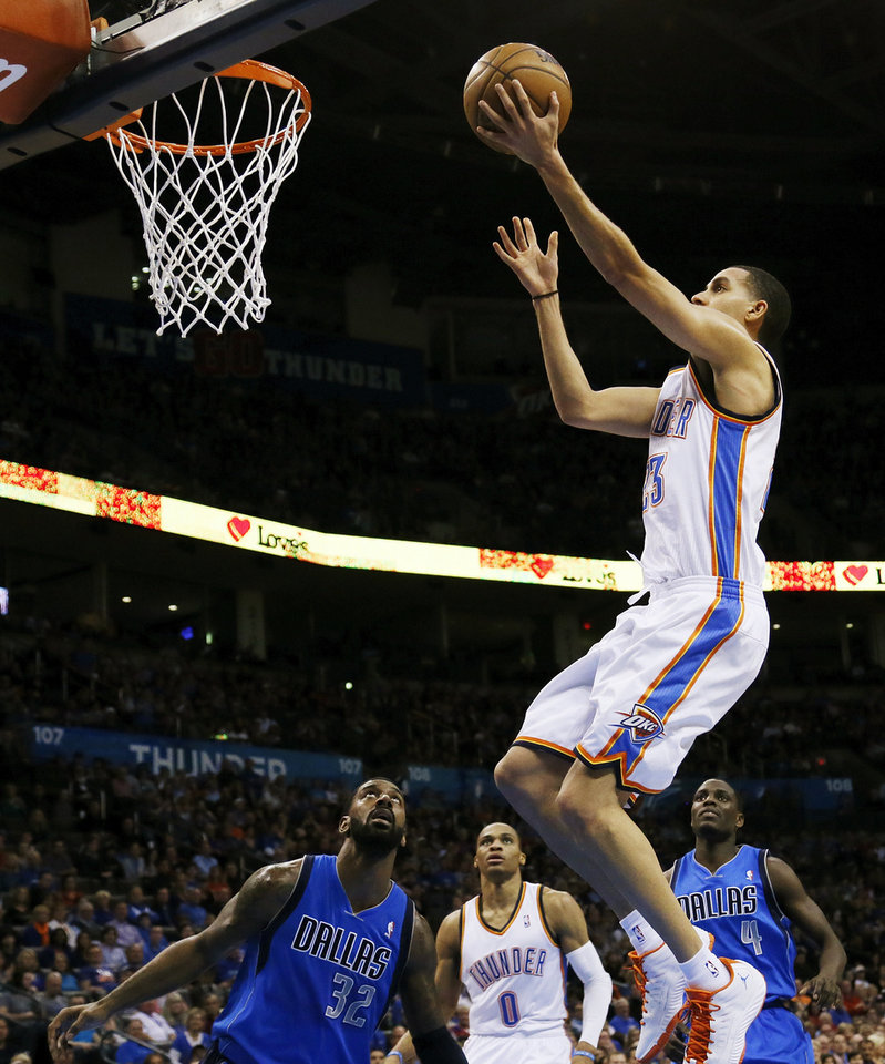 Oklahoma City\'s Kevin Martin (23) takes a shot as Russell Westbrook (0) along with Dallas\' O.J. Mayo (32) and Darren Collison (4) look on during an NBA basketball game between the Oklahoma City Thunder and the Dallas Mavericks at Chesapeake Energy Arena in Oklahoma City, Monday, Feb. 4, 2013. Photo by Nate Billings, The Oklahoman
