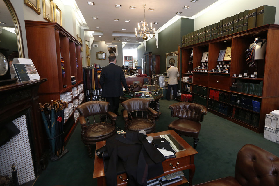 Photo - In this photo taken Friday, June 6, 2014, the inside of Henry Poole & Co tailor, the first shop to set up in Savile Row in 1846, is seen, on Savile Row in London, Friday, June 6, 2014. In the world of women's fashion, London often seems to play second fiddle to other style capitals: It lacks the allure of Paris's haute couture, or the polish of Milan's luxury labels. But it's a whole different story when it comes to dressing men. Steeped in a rich history of tailoring for kings, army generals and the world's wealthiest men, London is now marketed as the home of men's fashion - the original birthplace of the tuxedo jacket, the bowler hat and the three-piece suit, among other classic items. When trendy designers like Alexander McQueen and Burberry kick off the new season's menswear shows in the British capital Sunday, the catwalks will be staged just blocks away from elite tailoring houses that have been perfecting their craft for over a century. Savile Row, a street lined with more than a dozen tailors and a living museum of the English love affair with luxury menswear, has a long-standing tradition closely tied to a history in royal dress, military uniforms and gentry sports like horseback riding and hunting. (AP Photo/Sang Tan)