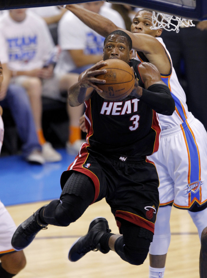 Miami's Dwyane Wade (3) goes past Oklahoma City's Russell Westbrook (0) during Game 2 of the NBA Finals between the Oklahoma City Thunder and the Miami Heat at Chesapeake Energy Arena in Oklahoma City, Thursday, June 14, 2012. Photo by Chris Landsberger, The Oklahoman