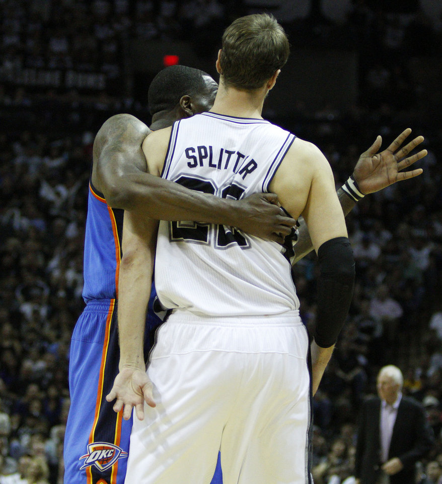 Oklahoma City\'s Kendrick Perkins (5) fouls San Antonio\'s Tiago Splitter (22) during Game 2 of the Western Conference Finals between the Oklahoma City Thunder and the San Antonio Spurs in the NBA playoffs at the AT&T Center in San Antonio, Texas, Tuesday, May 29, 2012. Photo by Bryan Terry, The Oklahoman