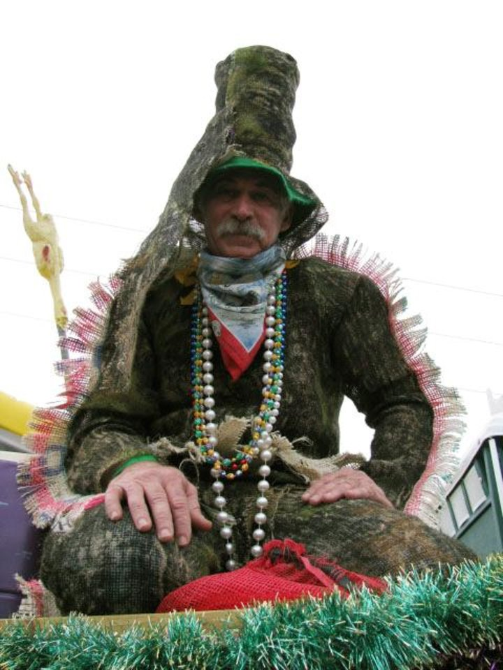 Photo - FILE - This Feb. 5, 2008 file photo shows Brad Cormier atop a float, waiting for the rural Mardi Gras to leave Eunice, La. Cormier made his costume, in part, from his deer hunting blind. Mardi Gras includes days of live music, costume-making and an old-fashioned boucherie. (AP Photo/Becky Bohrer)
