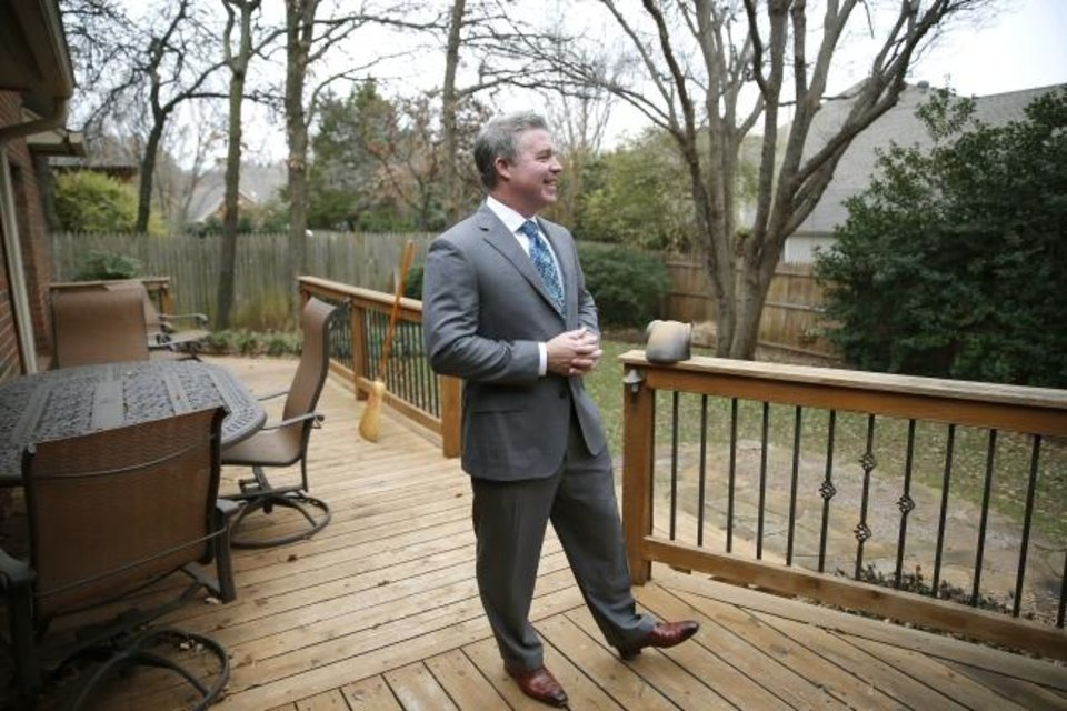Photo -  Realtor Nick Hilton, of RE/MAX Preferred, stands on the deck of a home he  has listed for sale at 2301 Powderhorn in Edmond. He was voted Most Cooperative Realtor for 2018 by the Oklahoma City Metro Association of Realtors.  [SARAH PHIPPS/THE OKLAHOMAN]