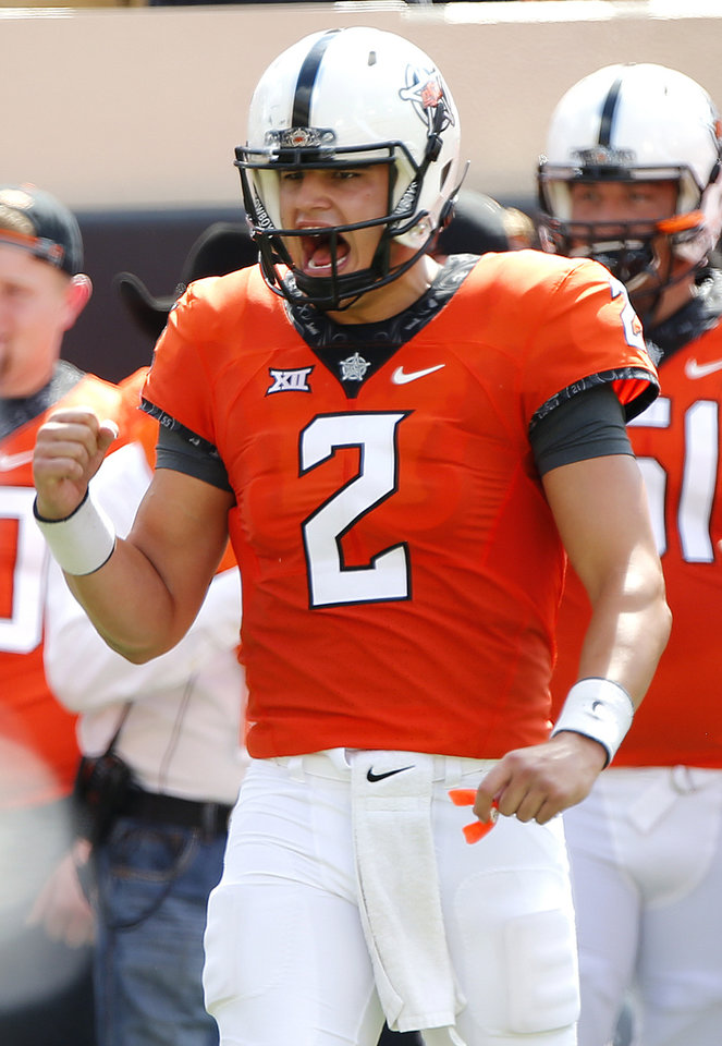 Photo - Oklahoma State quarterback Mason Rudolph has beaten every team in the Big 12 except one -- Baylor. The Cowboys and Bears play at 6:30 p.m. Saturday. (Photo by Chris Landsberger, The Oklahoman)