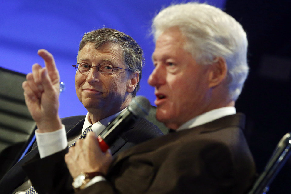 Photo - Former President Bill Clinton and Microsoft founder and philanthropist Bill Gates, speak about debt at the 2013 Fiscal Summit in Washington, Tuesday, May 7, 2013. (AP Photo/Charles Dharapak)