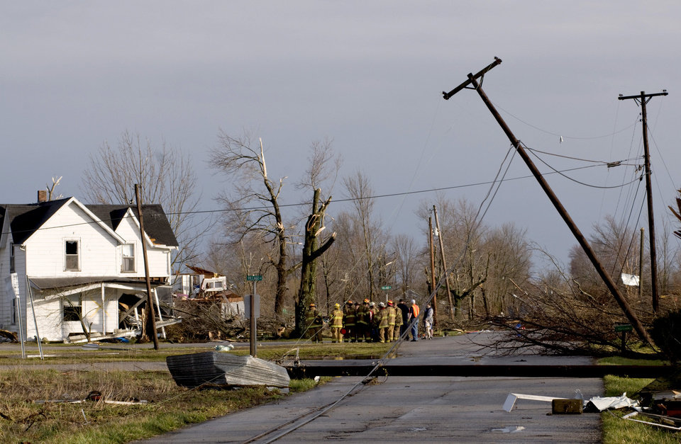 Residents of Marysville, Ind., survey the tornado damage to their homes Friday, March 2, 2012 in Marysville, Ind. Powerful storms stretching from the U.S. Gulf Coast to the Great Lakes in the north wrecked two small towns, killed at least three people and bred anxiety across a wide swath of the country on Friday, in the second deadly tornado outbreak this week. (AP Photo/Brian Bohannon) ORG XMIT: KYBB106