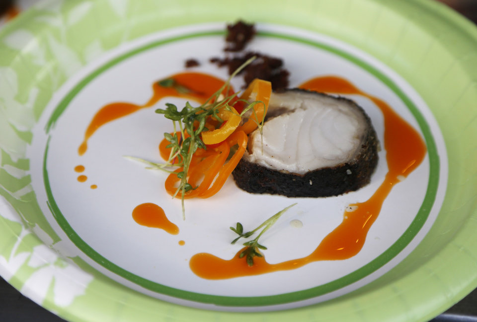 Photo -  Chris McCabe, with A Good Egg Dining Group, made pan-seared sablefish with chorizo and pickled peppers. Photo by Doug Hoke, The Oklahoman   DOUG HOKE -  THE OKLAHOMAN
