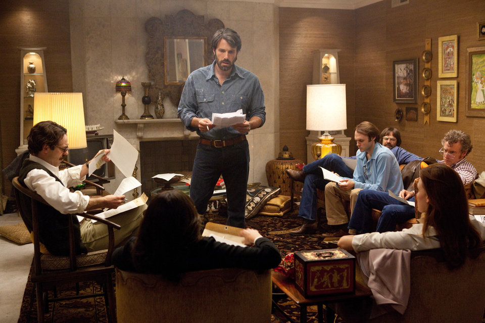 "This film image released by Warner Bros. Pictures shows Ben Affleck as Tony Mendez, center, in ""Argo,""  a rescue thriller about the 1979 Iranian hostage crisis. On Thursday, Dec. 13, 2013, Affleck was nominated for a Golden Globe for best director and ""Argo"" received a nomination for best film.  The 70th annual Golden Globe Awards will be held on Jan. 13.  (AP Photo/Warner Bros., Claire Folger)"