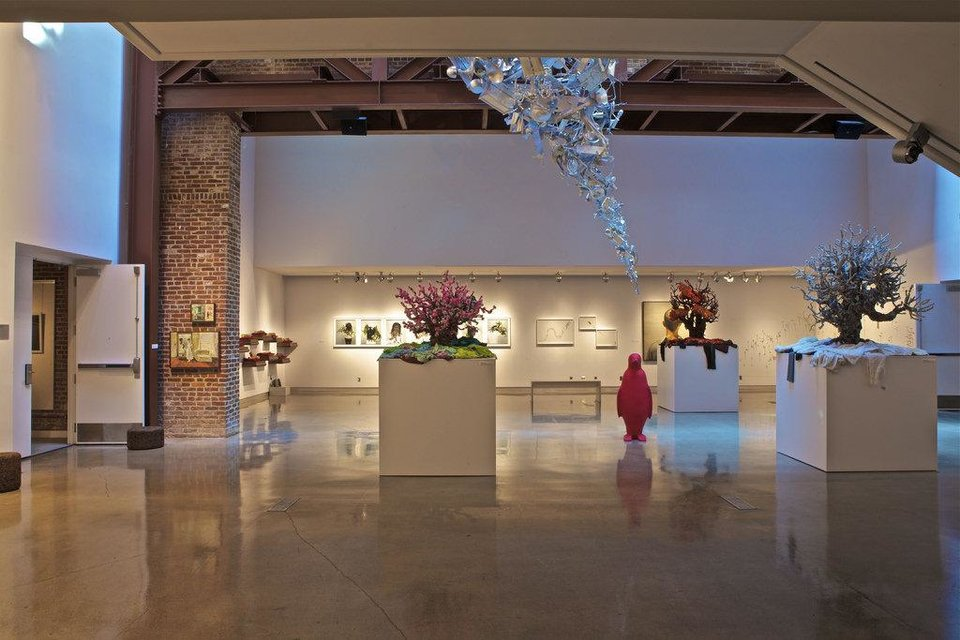 Photo - Large contemporary art galleries with rotating displays are the centerpiece of each 21c Museum Hotel, as shown in this photo of an exhibit at the chain's Louisville, Ky. flagship hotel.  Provided