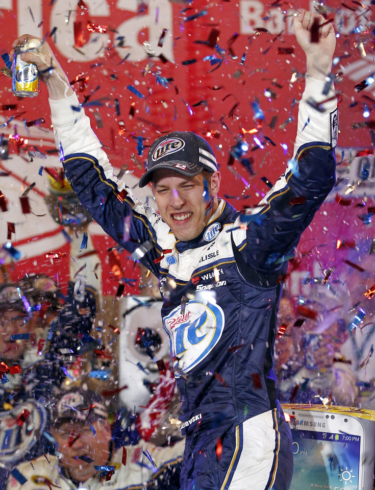 Photo - Brad Keselowski celebrates in Victory Lane after winning the NASCAR Sprint Cup Series auto race at Charlotte Motor Speedway in Concord, N.C., Saturday, Oct. 12, 2013. (AP Photo/Terry Renna)