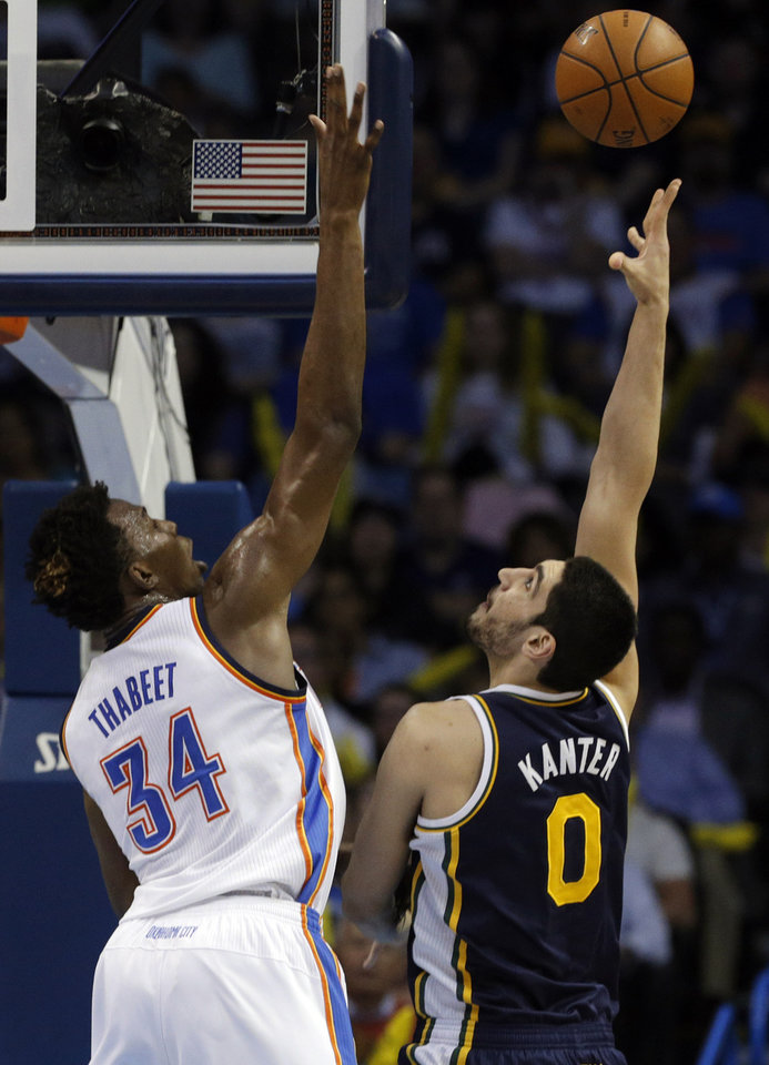 Photo - Oklahoma City 's Hasheem Thabeet (34) defends against Utah's Enes Kanter (0) during the NBA game between the Oklahoma City Thunder and the Utah Jazz at the Chesapeake Energy Arena, Sunday, March 30, 2014, in Oklahoma City. Photo by Sarah Phipps, The Oklahoman