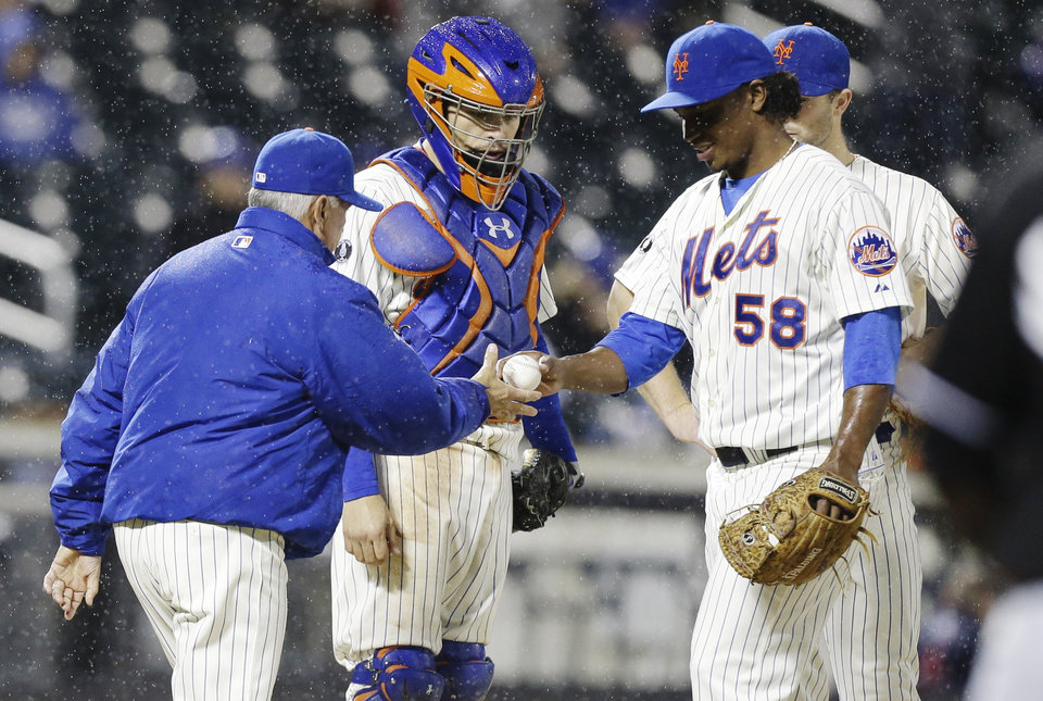 Photo - New York Mets manager Terry Collins, left, takes starting pitcher Jenrry Mejia (58) out of the game during the sixth inning of a baseball game against the Miami Marlins, Saturday, April 26, 2014, in New York. (AP Photo/Frank Franklin II)