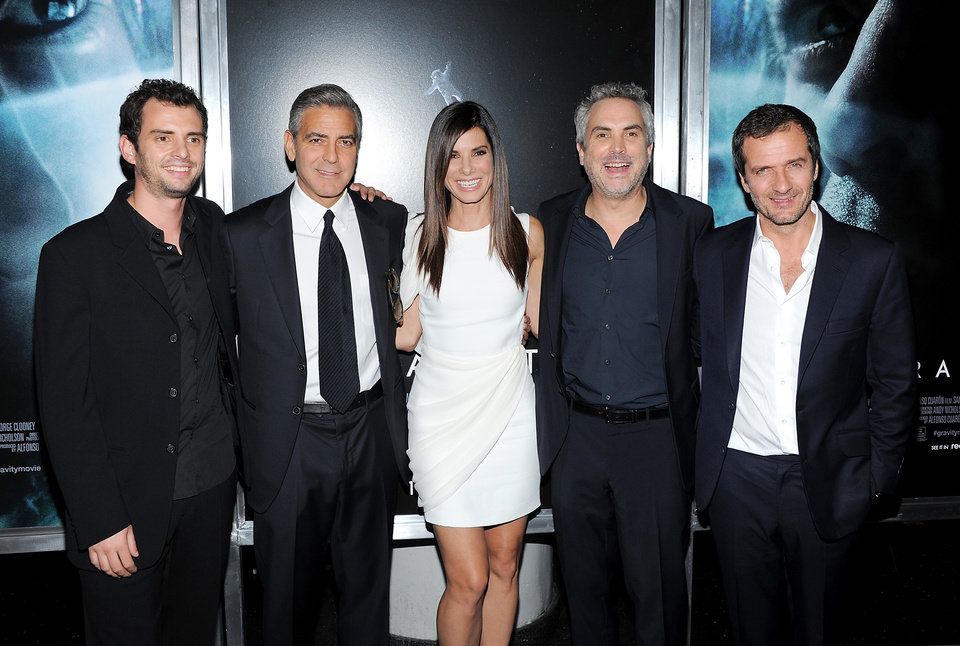 "Photo - From left, screenwriter Jonas Cuaron, actor George Clooney, actress Sandra Bullock, director Alfonso Cuaron and producer David Heyman pose together at the premiere of ""Gravity"" at the AMC Lincoln Square Theaters on Tuesday, Oct. 1, 2013, in New York. (Photo by Evan Agostini/Invision/AP) ORG XMIT: NYEA135"