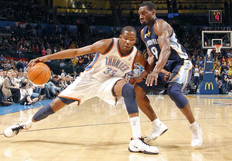 The Thunder's Kevin Durant (35) tries to drive the ball on Memphis' Tony Allen (9) during the NBA basketball game between the Oklahoma City Thunder and the Memphis Grizzlies at the Oklahoma City Arena on Tuesday, Feb. 8, 2011, Oklahoma City, Okla.  Photo by Chris Landsberger, The Oklahoman