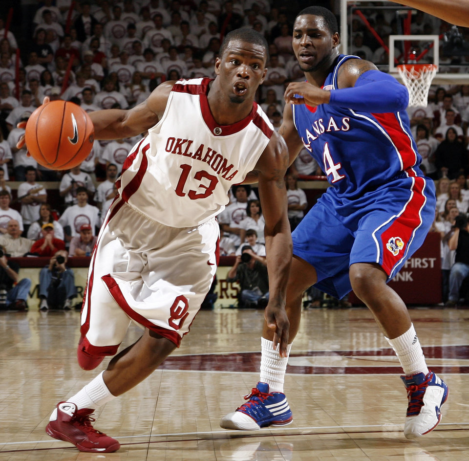 OU's Willie Warren (13) drives past Sherron Collins (4) of KU in the second half of the men's college basketball game between Kansas and Oklahoma at the Lloyd Noble Center in Norman, Okla., Monday, February 23, 2009. KU won, 87-78. BY NATE BILLINGS, THE OKLAHOMAN